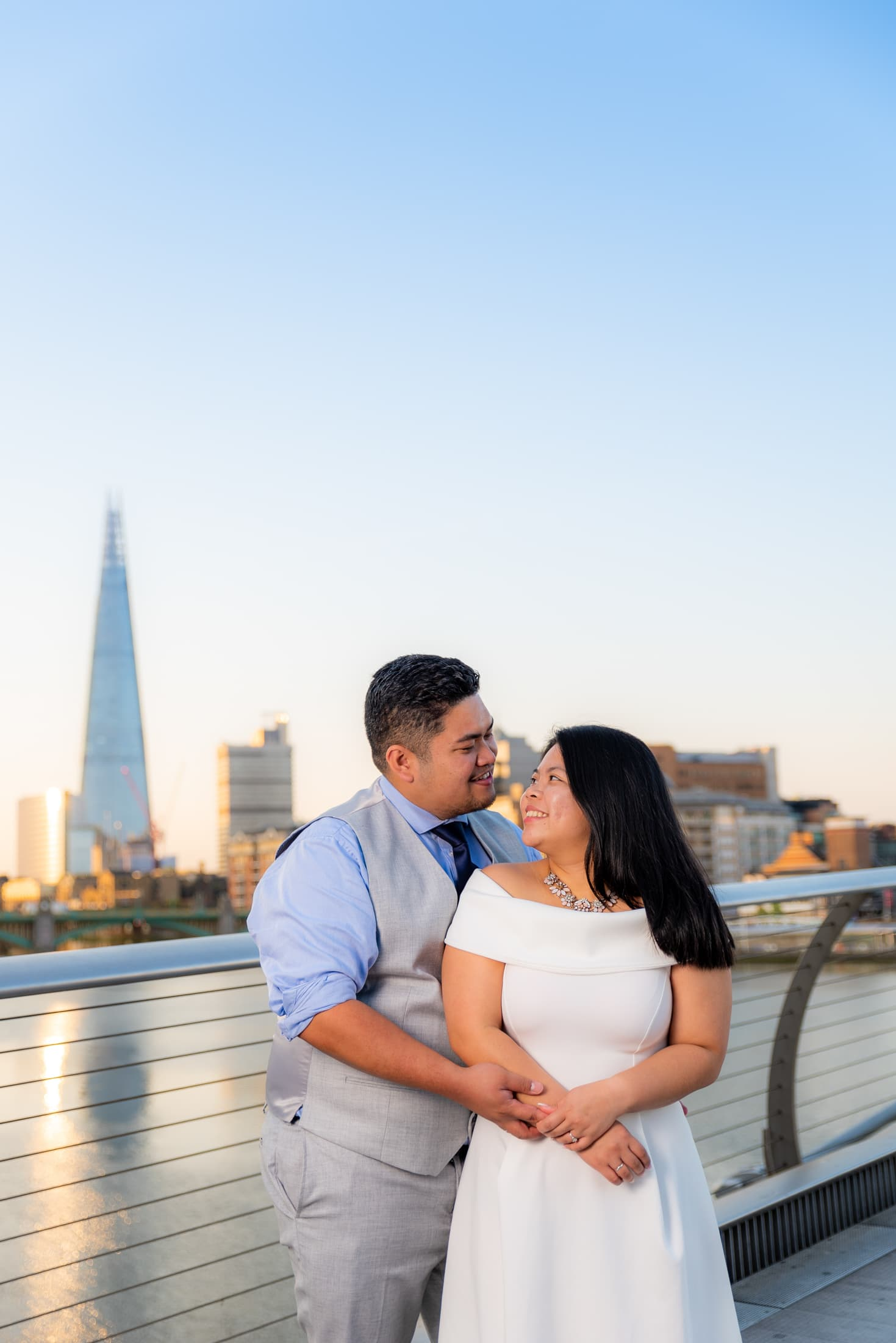 Kat and Naph enjoying a wonderful early morning pre-wedding session on the millennium bridge with the shard in the back ground