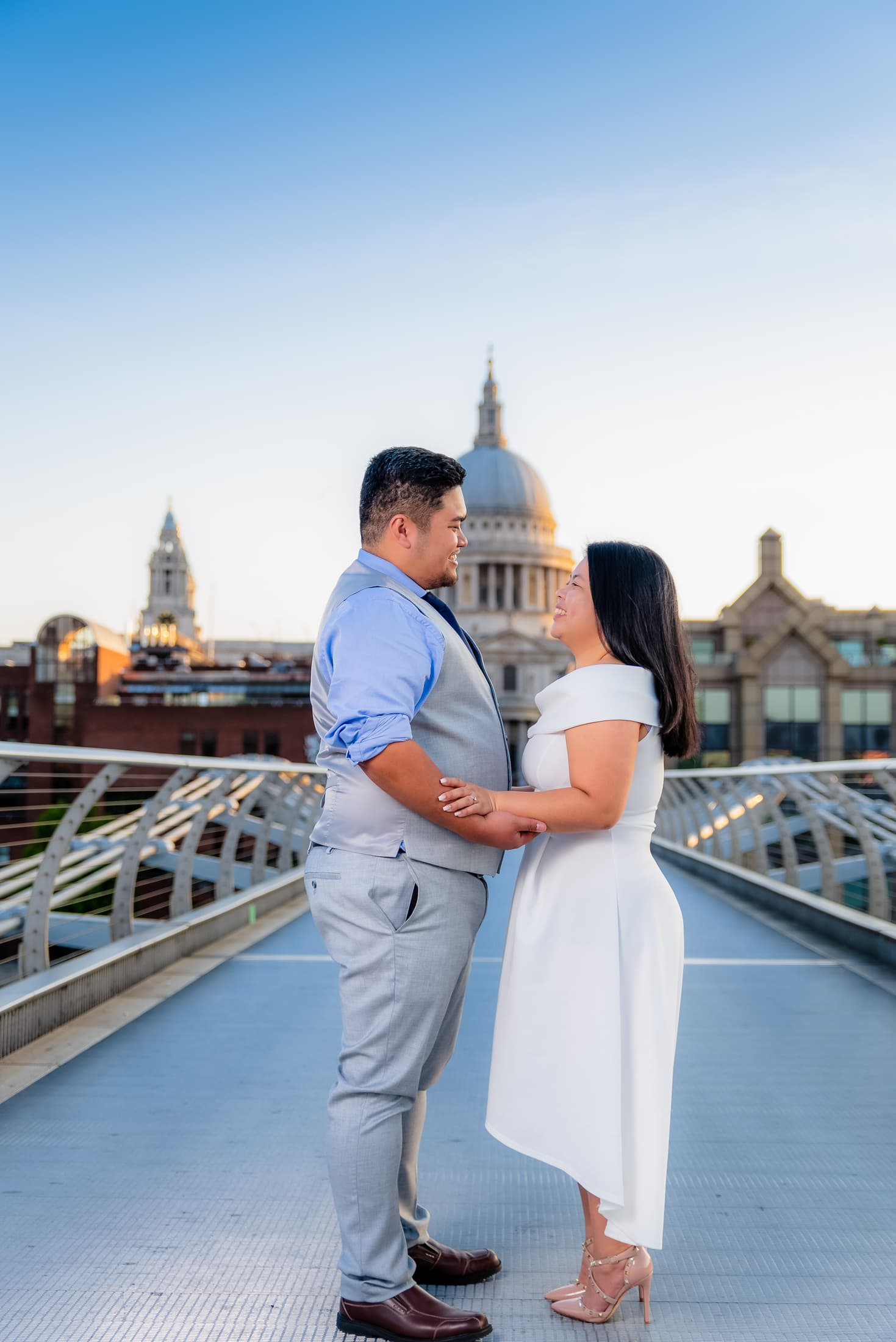 Kat and Naph enjoying a wonderful early morning pre-wedding session on the millennium bridge with St Pauls cathedral in the back ground