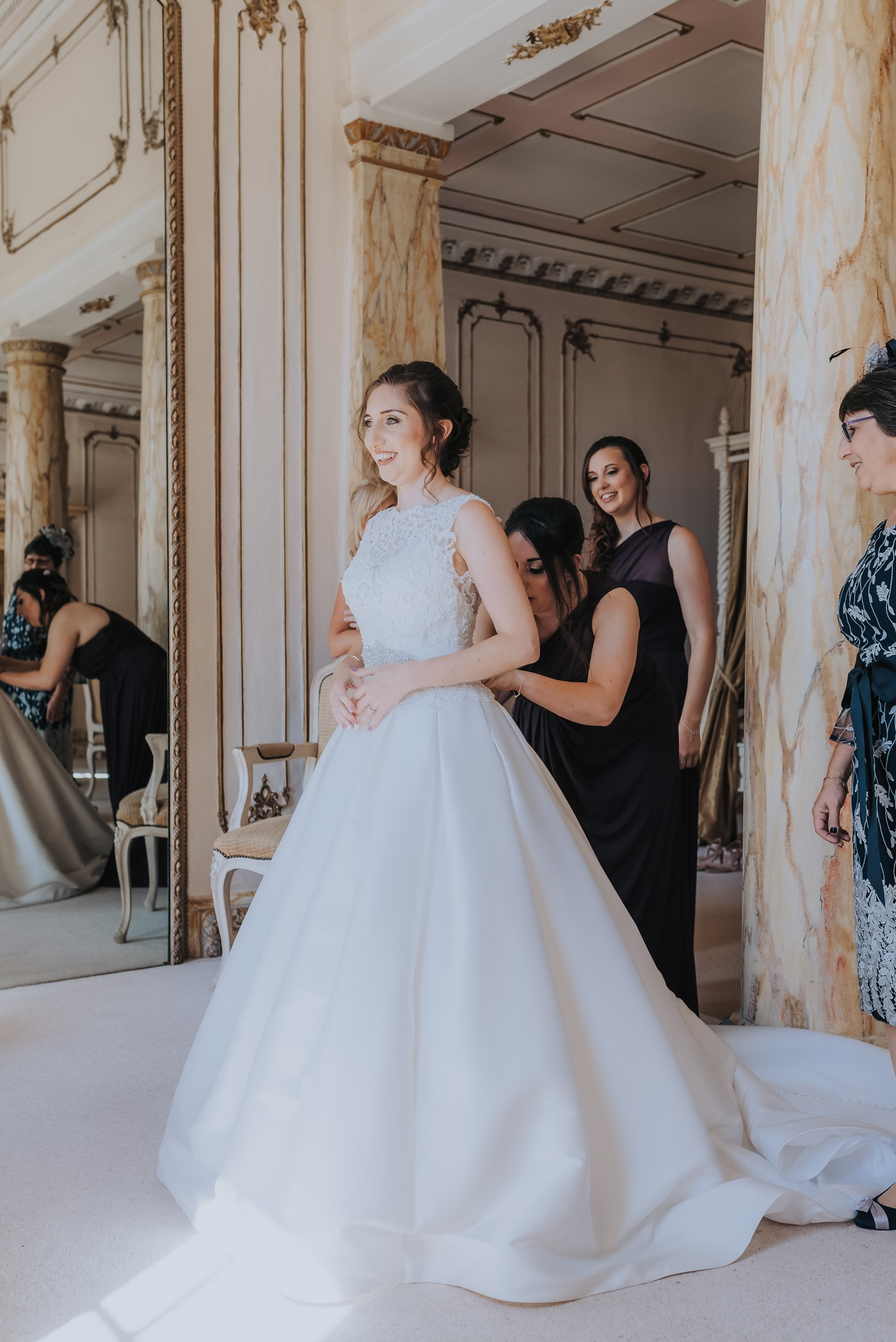 Essex Country House Wedding - bride in the Rococo bridal suite at gosfield hall
