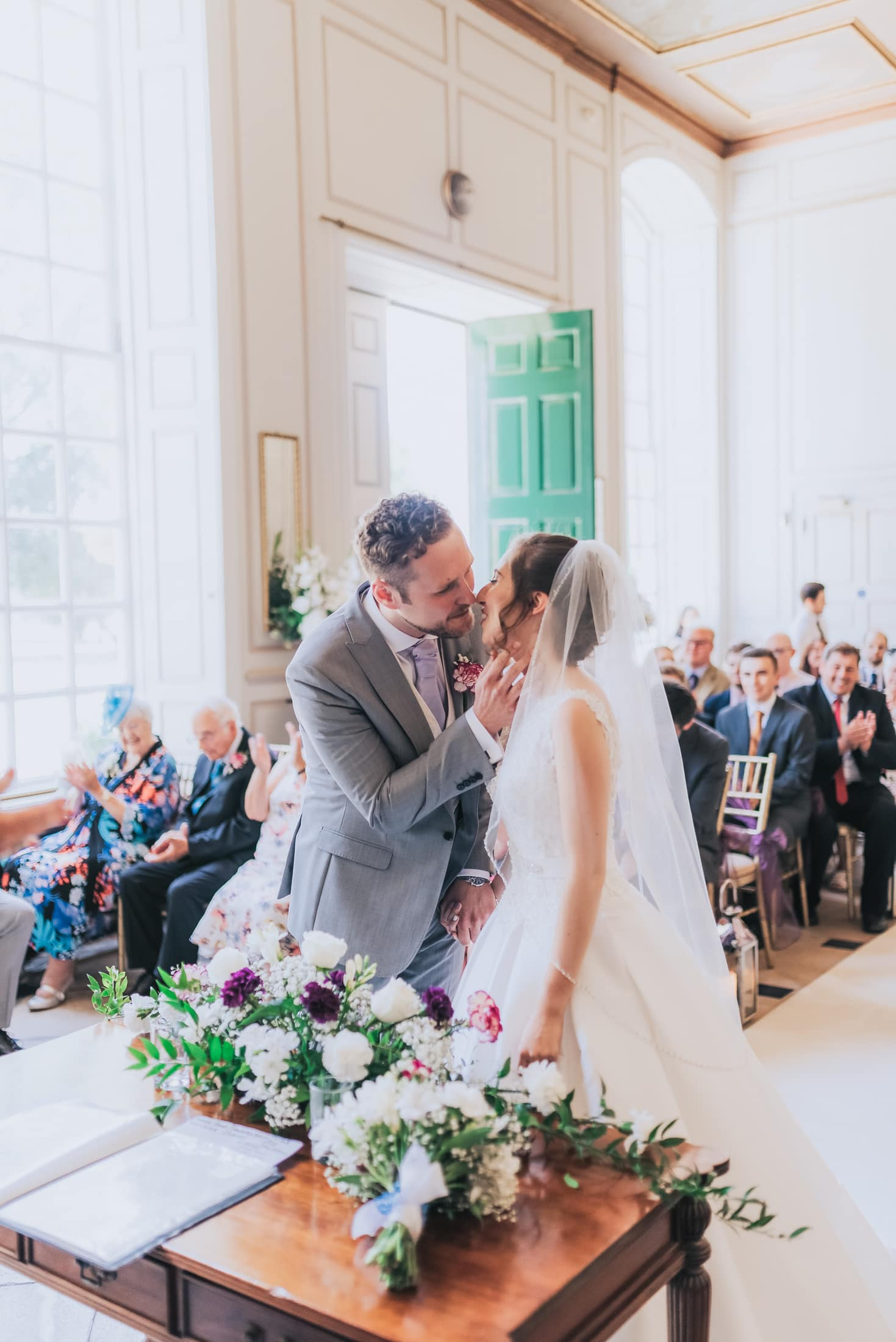 Bride and groom share their first kiss as Husband and wife - Essex Country House Wedding - Gosfield Hall