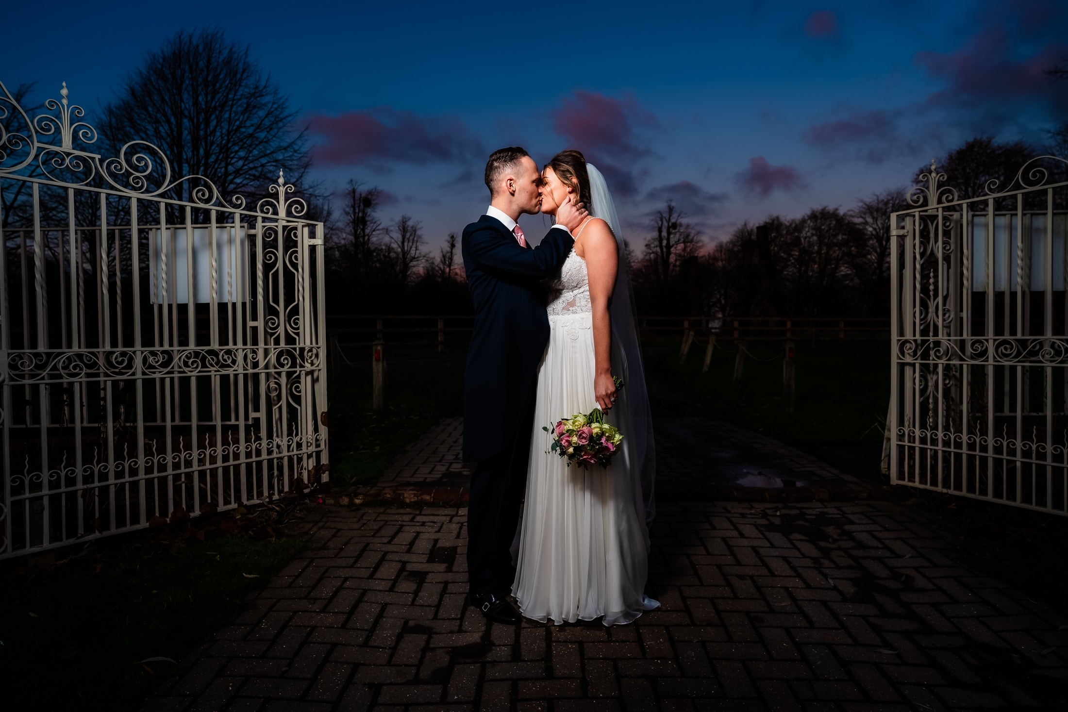 couple at parklands wedding venue in Essex share a kiss - essex wedding photographer - lily and white