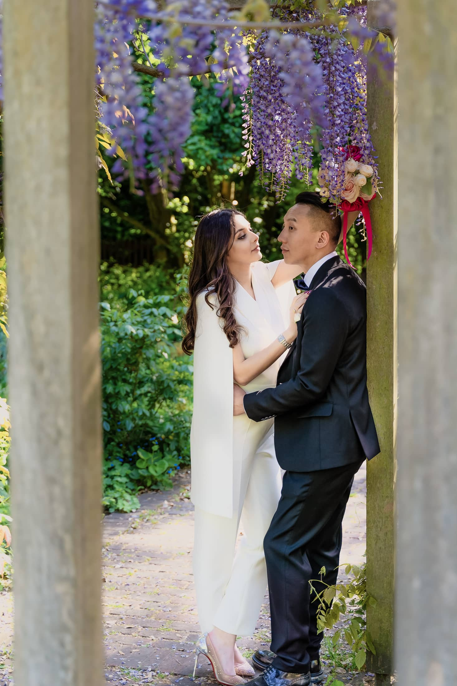 bride and groom share a moment at Battersea park in London